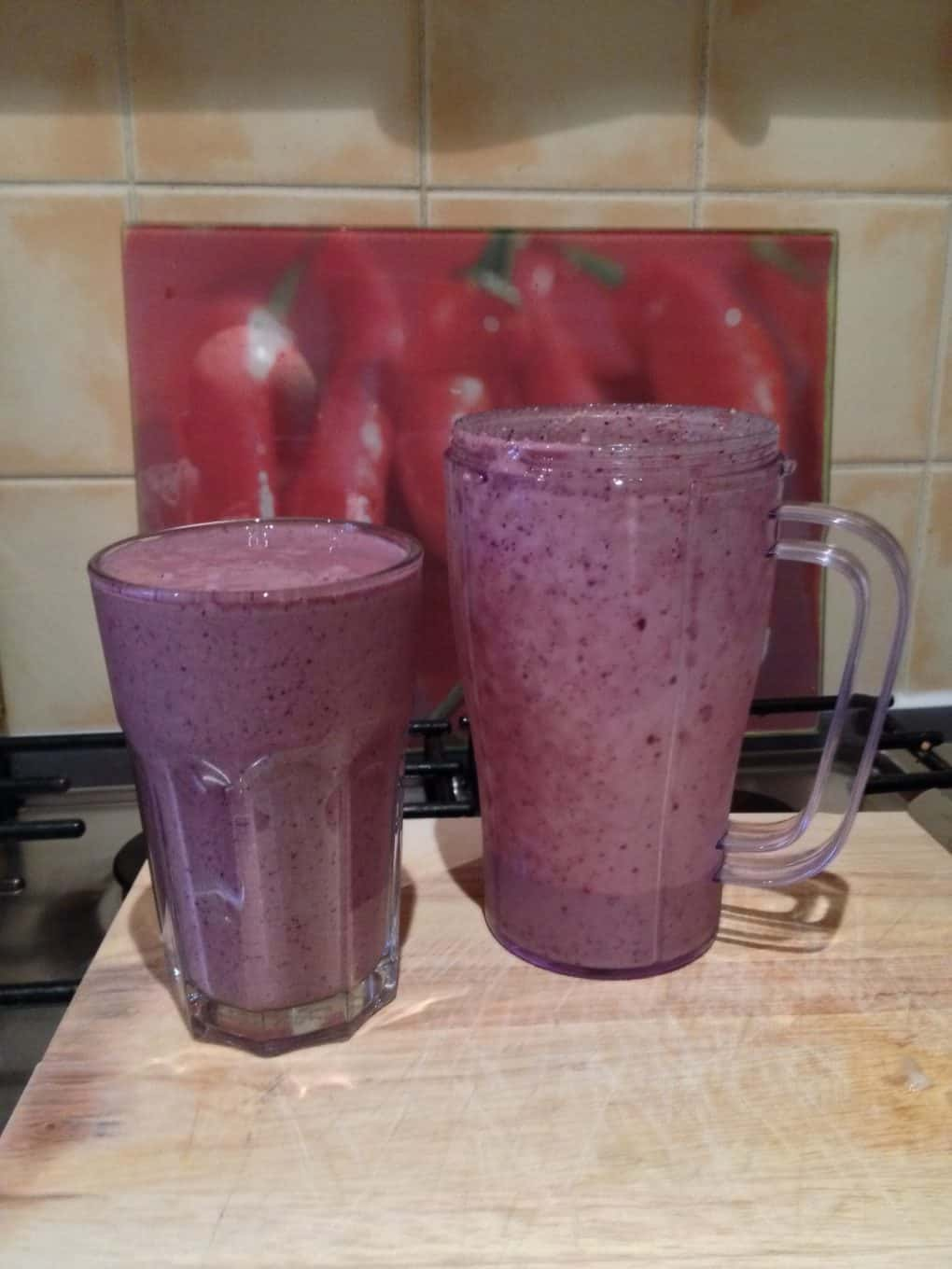 Picture of a glass and jug of delicious smoothie