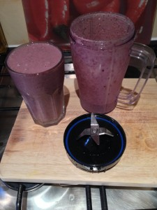 Glass & Jug of Banana & Blueberry Granola Breakfast Smoothie