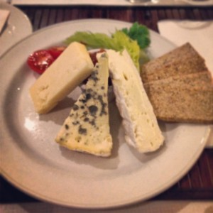 plate of cheese and oatcakes with chutney