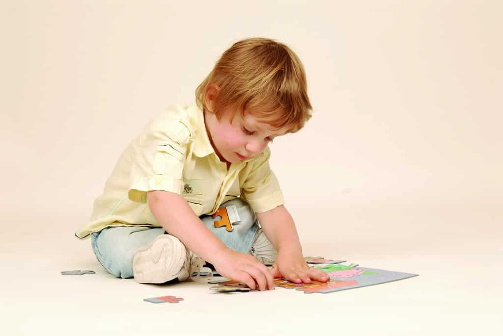 Child and Jigsaw Puzzle