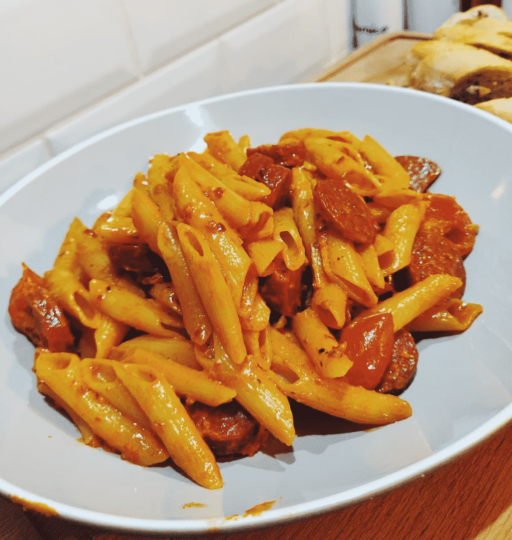 Pasta Dish With Chorizo and Tomatoes in a pasta bowl